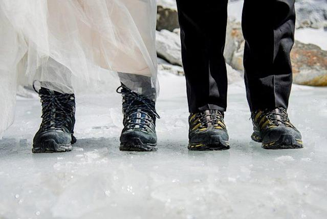 Both Sissom and Schmieder wore hiking boots during the ceremony to stay safe. (Photo: Charleton Churchill/Caters News)