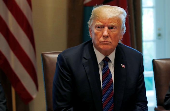 President Donald Trump reversed course on Monday, issuing a formal statement honoring the late Sen. John McCain. (Photo: Leah Millis/Reuters)