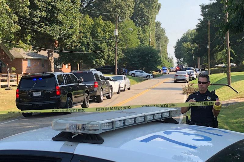 Police cordon off the scene of a shooting in Memphis, Tenn., on Wednesday, Sept. 18, 2019. Officials say two deputies have been injured and a suspect has died in the shooting.