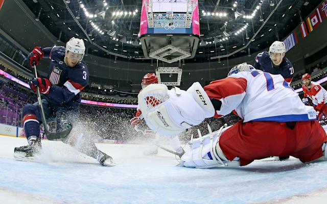 Russia goaltender Sergei Bobrovski can't stop a goal by USA defenseman Cam Fowler during the second period of a men's ice hockey game at the 2014 Winter Olympics, Saturday, Feb. 15, 2014, in Sochi, Russia. (AP Photo/Bruce Bennett, Pool)