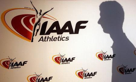 FILE PHOTO - A man casts his shadow following a press conference by Sebastian Coe, IAAF's President, as part of the 203nd International Association of Athletics Federations (IAAF) council meeting in Monaco, March 11, 2016. REUTERS/Eric Gaillard/File Photo