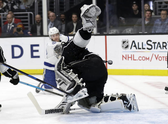 Los Angeles Kings goaltender Jonathan Quick, center, gives up a goal on a shot from Tampa Bay Lightning's Brayden Point, background, during the first period of an NHL hockey game Thursday, Jan. 3, 2019, in Los Angeles. (AP Photo/Marcio Jose Sanchez)