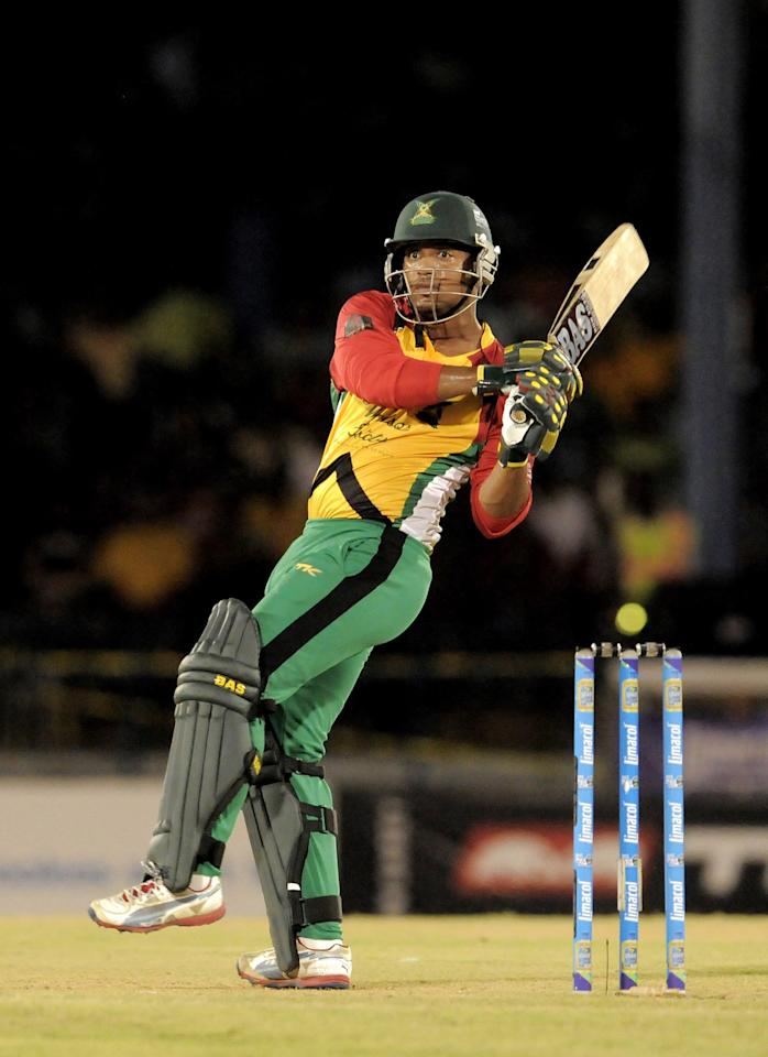 PORT OF SPAIN, TRINIDAD AND TOBAGO - AUGUST 24:  William Perkins of Guyana Amazon Warriors hits a 4 against Jamaica Tallawahs during the Final of the Caribbean Premier League between Guyana Warriors v Jamaica Tallawahs at Queens Park Oval on August 24, 2013 in Port of Spain, Trinidad and Tobago. (Photo by Randy Brooks/Getty Images Latin America for CPL)
