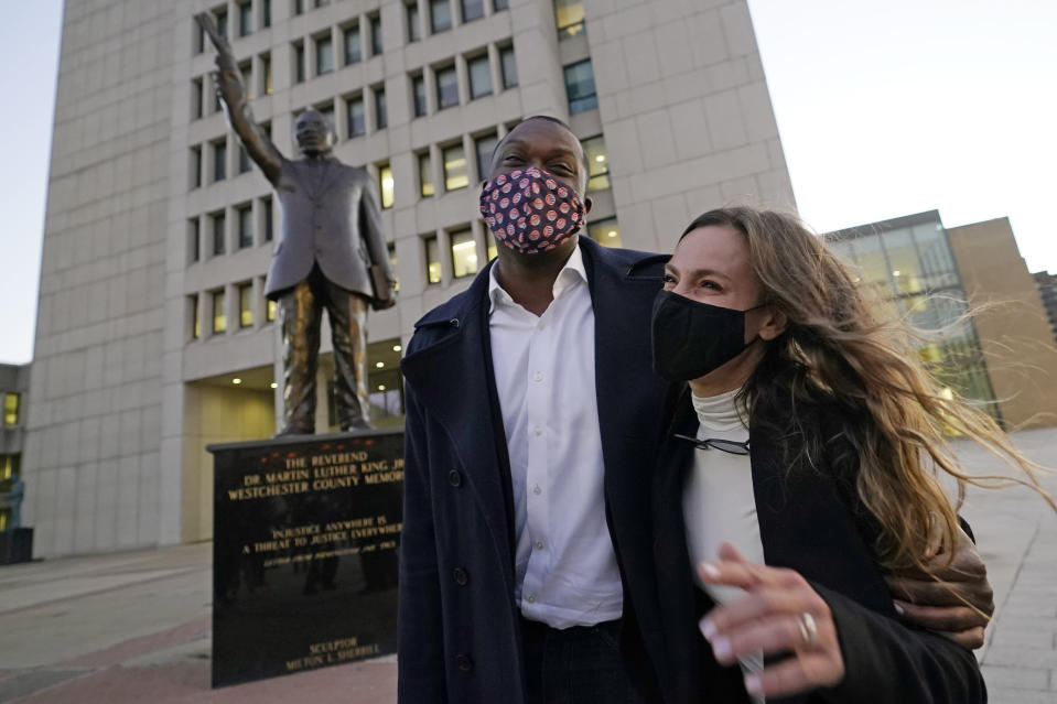 U.S. Rep.-elect Mondaire Jones, D-N.Y. celebrates with New York State Sen. Alessandra Biaggi, N.Y.-34, after speaking at a Protect the Results rally, Wednesday, Nov. 4, 2020, in front of the Westchester County Courthouse in White Plains, N.Y. Jones and Ritchie Torres became the first openly-gay Black members of Congress. Both New Yorkers will enter Congress in January. (AP Photo/Kathy Willens)