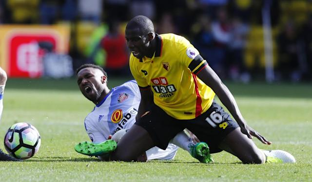 <p>Watford's Abdoulaye Doucoure in action with Sunderland's Jermain Defoe </p>