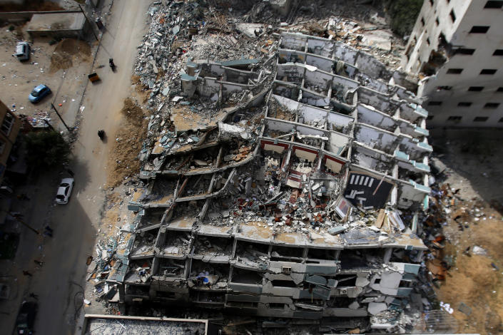 The destroyed building housing the offices of The Associated Press and other media, after it was hit last week by Israeli airstrike, in Gaza City, Friday, May 21, 2021. A cease-fire took effect early Friday after 11 days of heavy fighting between Israel and Gaza's militant Hamas rulers that was ignited by protests and clashes in Jerusalem. (AP Photo/Hatem Moussa)