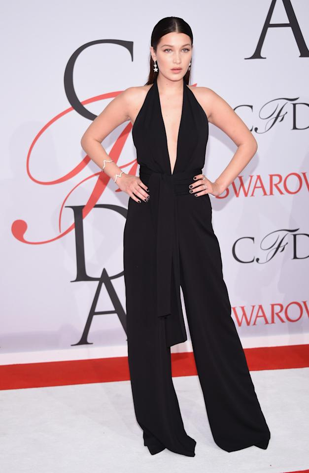 While her sister shined in gold Michael Kors, Bella Hadid, also in a jumpsuit, went for a more classic look in a black Misha Nonoo number.