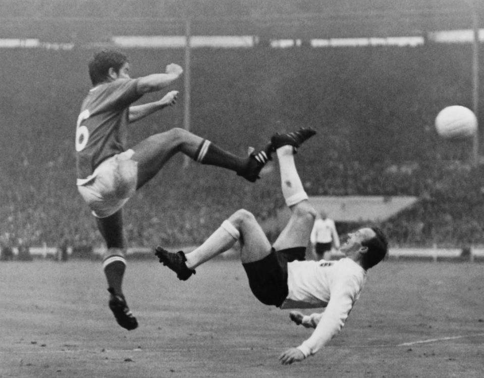 French football player Robert Budzynski (L) kicks the ball against his British opponent Nobby Stiles (Norbert Stiles,R) on July 20, 1966, during the match France / England of the football World Cup, at the Wembley Stadium, in England. / AFP / STRINGER (Photo credit should read STRINGER/AFP via Getty Images)