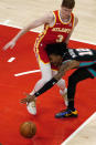 Memphis Grizzlies guard Ja Morant (12) loses control of the ball as he crashes into Atlanta Hawks guard Kevin Huerter (3) in the first half of an NBA basketball game Wednesday, April 7, 2021, in Atlanta. (AP Photo/John Bazemore)