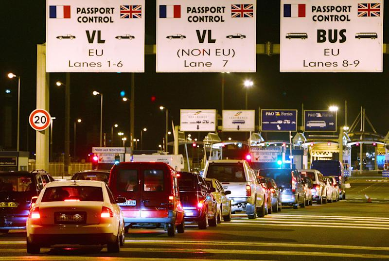 Passenger vehicles wait to check-in at the ferry port in Calais, France, as travel disruption continues into a third day after French fishermen blockaded the port during a strike over EU fishing quotas.