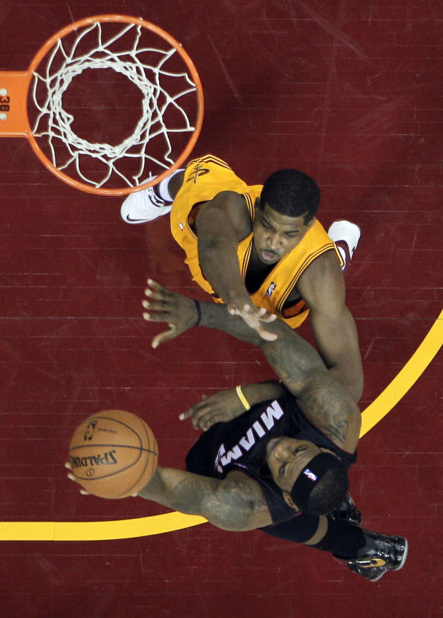Miami Heat's LeBron James, bottom, shoots over Cleveland Cavaliers' Tristan Thompson in the second half of an NBA basketball game Wednesday, Nov. 27, 2013, in Cleveland. James scored 28 points in a 95-84 win over the Cavaliers. (AP Photo/Mark Duncan)