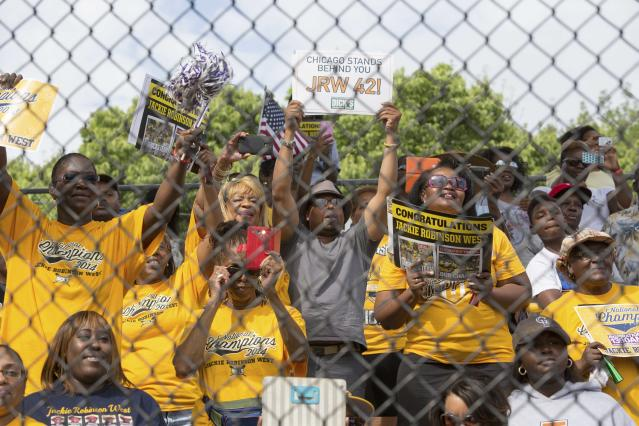 Fans cheer during a rally for the Jackie Robinson West All Stars baseball team Wednesday, Aug. 17, 2014, in Chicago before the team headed out for a parade to honor their play at the Little League World Series in South Williamsport, Pa. The all-black team claimed the U.S. title in the Little League World Series. (AP Photo/Theresa Crawford)