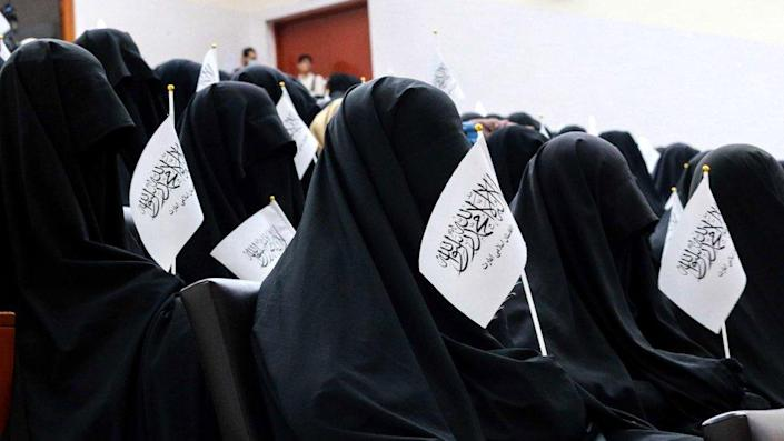 Afghan students listen to women speakers prior to a pro-Taliban rally outside the Shaheed Rabbani Education University in Kabul on 11 September 2021