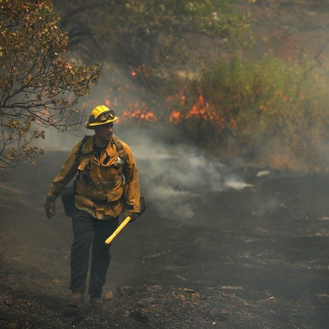 Thousands of firefighters struggle to contain giant blazes in California