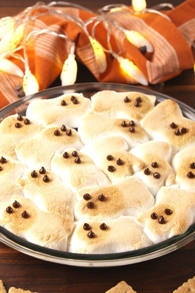 """<p>This s'mores dip will have you reliving your most fun camping memories from the comfort of your couch. </p><p><strong><em>Get the recipe at <a href=""""https://www.delish.com/cooking/recipe-ideas/recipes/a55544/ghost-smores-recipe/"""" rel=""""nofollow noopener"""" target=""""_blank"""" data-ylk=""""slk:Delish"""" class=""""link rapid-noclick-resp"""">Delish</a>. </em></strong></p>"""