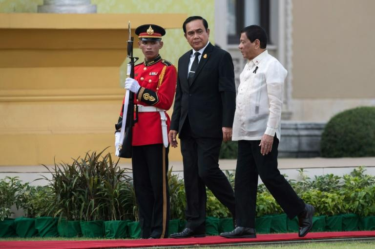 Donald Trump has invited both Thai Prime Minister Prayut Chan-O-Cha (C) and Philippines' President Rodrigo Duterte (R) to Washington