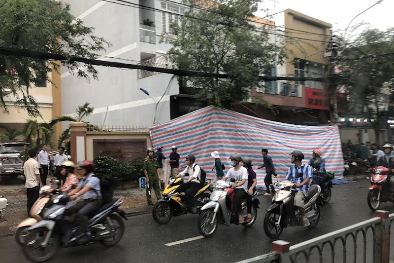 The bomb blew out the glass facade of a police station in Ho Chi Minh City (shown covered with a tarpaulin)