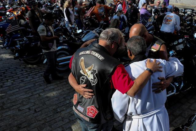 <p>Rolling Thunder motorcyclists, who ride annually on Memorial Day in support of U.S. military veterans, pray with an Episcopal priest as they have their bikes blessed during a brief service at the National Cathedral in Washington, May 25, 2018. (Photo: Jonathan Ernst/Reuters) </p>