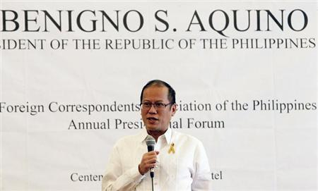 Philippines' President Aquino answer questions during a FOCAP forum at a hotel in Manila