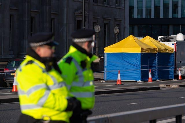 Police tents outside Fishmongers' Hall, on London Bridge, following the terror attack