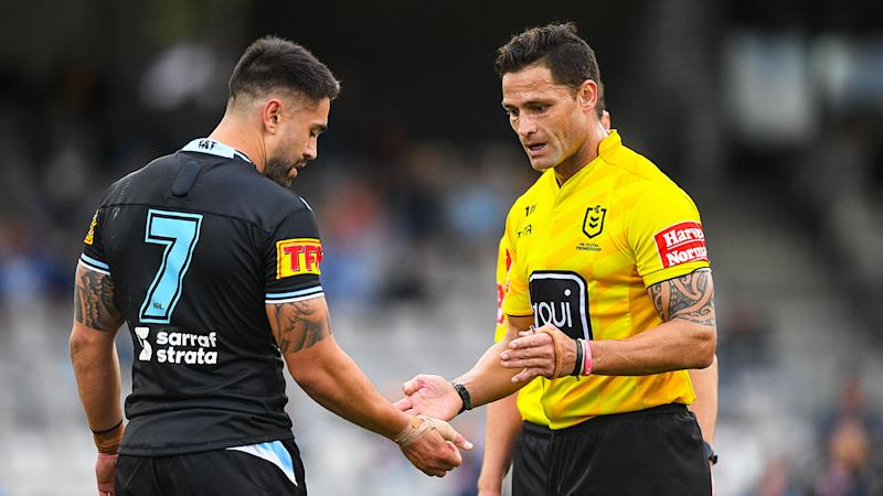 Shaun Johnson can be seen here showing the referee the teeth marks on his arm.