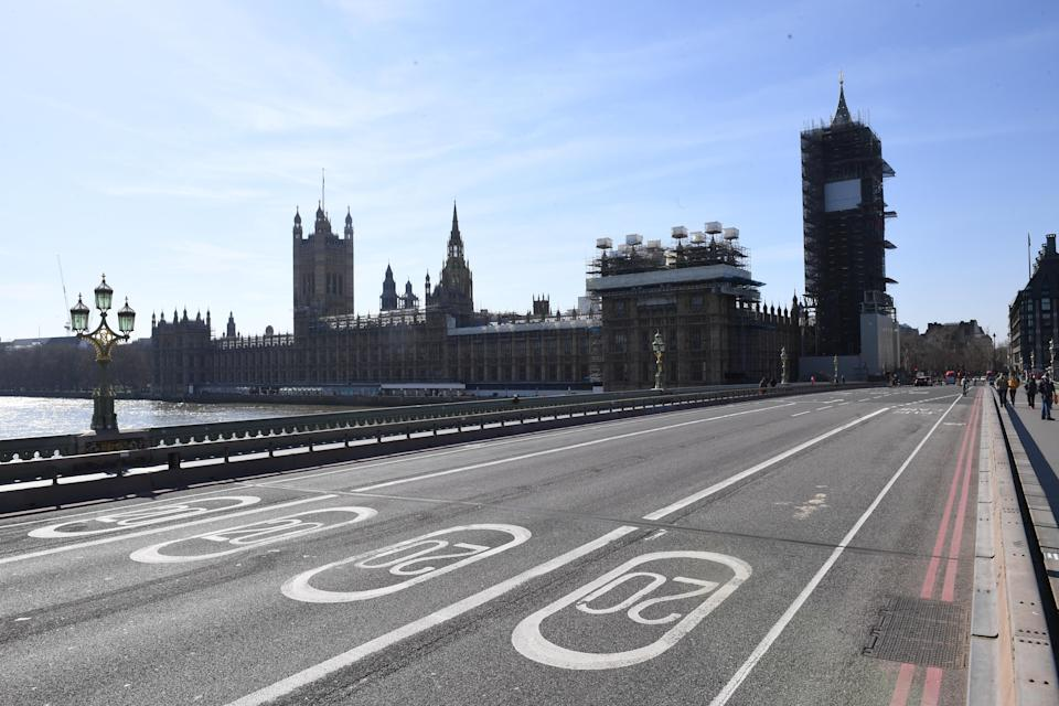 An empty Westminster Bridge and the Houses of Parliament in Westminster, London, the day after Prime Minister Boris Johnson put the UK in lockdown to help curb the spread of the coronavirus