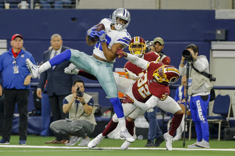 ARLINGTON, TX - DECEMBER 29: Dallas Cowboys wide receiver Amari Cooper (19) catches a pass for a first down over Washington Redskins cornerback Jimmy Moreland (32) during the game between the Dallas Cowboys and the Washington Redskins on December 29, 2019 at AT&T Stadium in Arlington, Texas.(Photo by Matthew Pearce/Icon Sportswire via Getty Images)