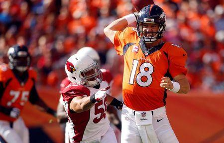 Oct 5, 2014; Denver, CO, USA; Denver Broncos quarterback Peyton Manning (18) throws the ball during the first half against the Arizona Cardinals at Sports Authority Field at Mile High. Mandatory Credit: Chris Humphreys-USA TODAY Sports