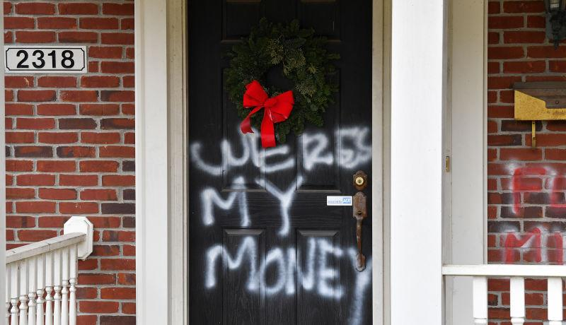 "Graffiti reading, ""Where's my money"" is seen on a door of the home of Senate Majority Leader Mitch McConnell, R-Ky., in Louisville, Ky., on Saturday, Jan. 2, 2021."