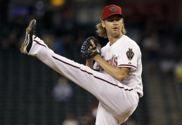 Arizona Diamondbacks' Bronson Arroyo winds up to throw a pitch against the Houston Astros during the first inning of a baseball game on Tuesday, June 10, 2014, in Phoenix. (AP Photo/Ross D. Franklin)