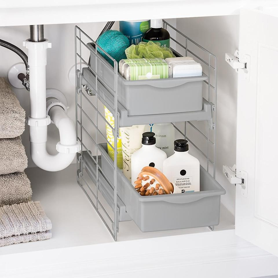 """<p>We love that this <a href=""""https://www.popsugar.com/buy/Sliding-2-Drawer-Organizer-547069?p_name=Sliding%202-Drawer%20Organizer&retailer=containerstore.com&pid=547069&price=20&evar1=casa%3Aus&evar9=47184923&evar98=https%3A%2F%2Fwww.popsugar.com%2Fhome%2Fphoto-gallery%2F47184923%2Fimage%2F47185115%2FSliding-2-Drawer-Organizer&list1=shopping%2Ccleaning%2Corganization%2Cspring%20cleaning%2Chome%20organization%2Chome%20shopping&prop13=api&pdata=1"""" rel=""""nofollow"""" data-shoppable-link=""""1"""" target=""""_blank"""" class=""""ga-track"""" data-ga-category=""""Related"""" data-ga-label=""""https://www.containerstore.com/s/whats-new/sliding-2-drawer-organizer/1d?productId=11012267"""" data-ga-action=""""In-Line Links"""">Sliding 2-Drawer Organizer</a> ($20) makes it easy to access all your products.</p>"""
