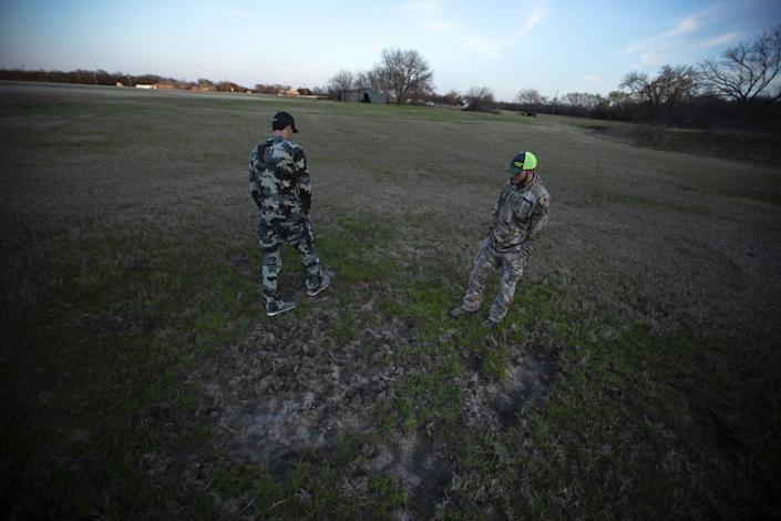 Hog hunters Sam Longhenry, left, and Dustin Parker in Wise County.