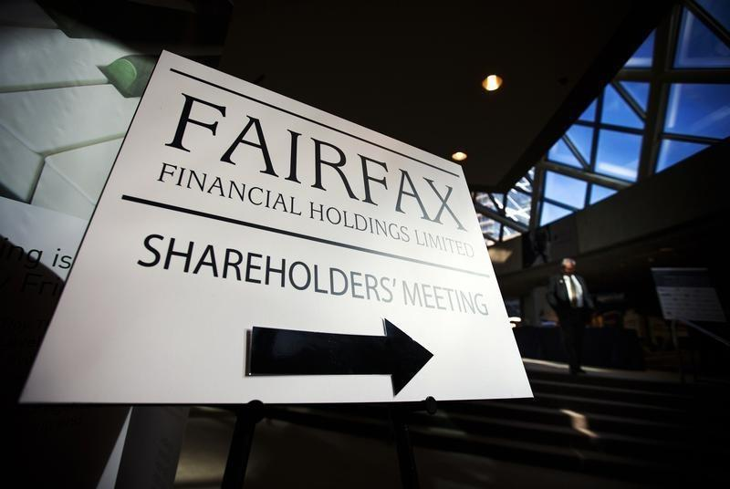 A man walks past a Fairfax Holdings sign directing shareholders to the meeting, at the annual general meeting for shareholders in Toronto