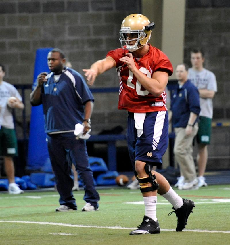 Notre Dame quarterback Dayne Crist throws a pass during the first spring NCAA college football practice for the team Wednesday March 23, 2011 in South Bend, Ind. (AP Photo/Joe Raymond)