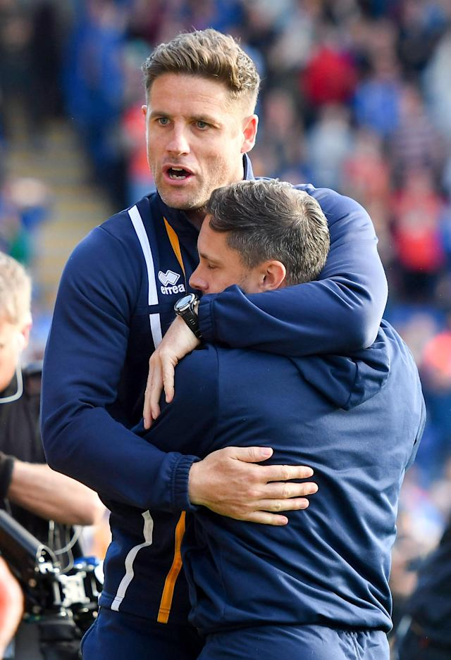 "Soccer Football - League One Play Off Semi Final Second Leg - Shrewsbury Town vs Charlton Athletic - Montgomery Waters Meadow, Shrewsbury, Britain - May 13, 2018 Shrewsbury Town manager Paul Hurst is congratulated at full time Action Images/Paul Burrows EDITORIAL USE ONLY. No use with unauthorized audio, video, data, fixture lists, club/league logos or ""live"" services. Online in-match use limited to 75 images, no video emulation. No use in betting, games or single club/league/player publications. Please contact your account representative for further details."