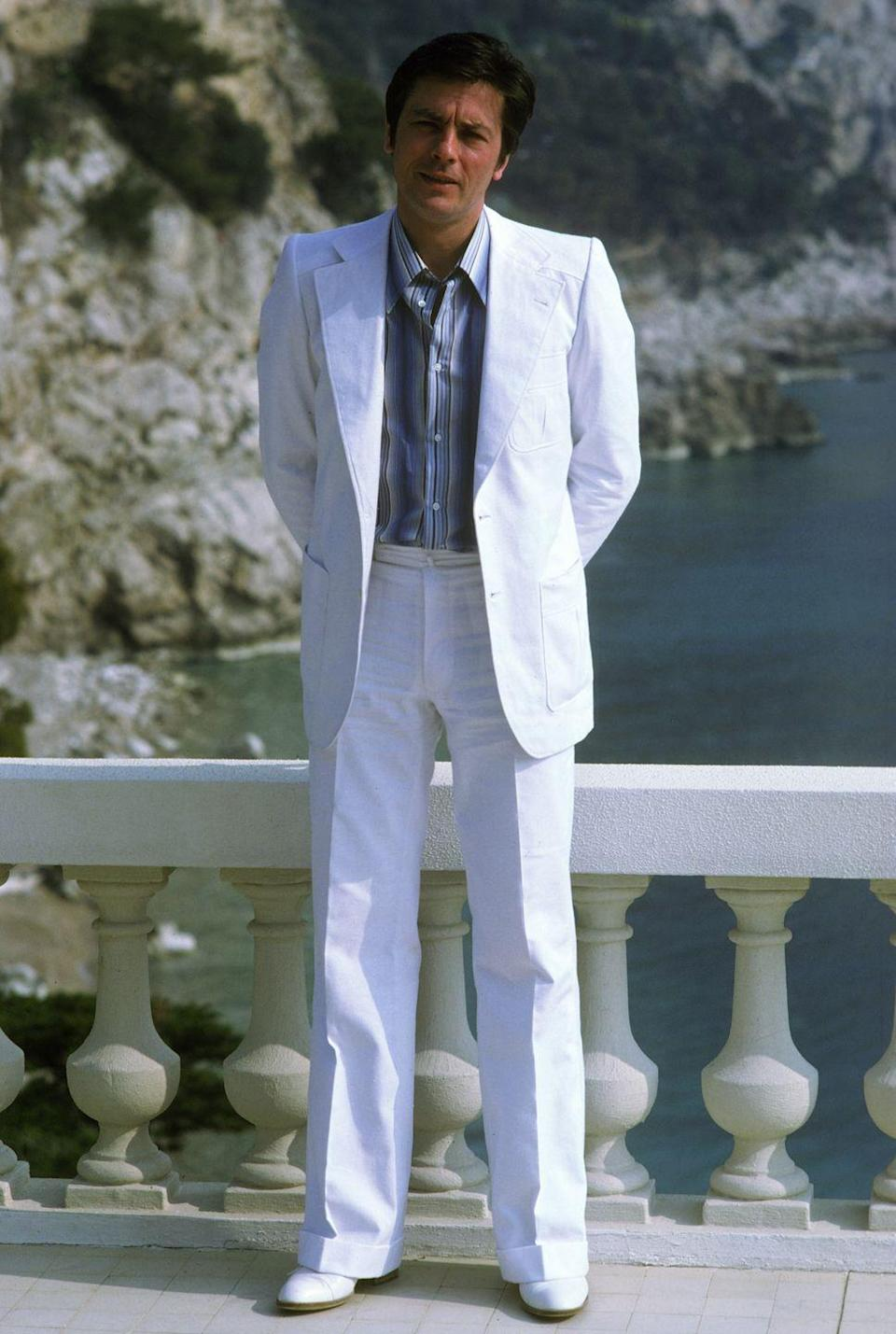 <p>Always a tough guy—even at 40, especially at 40—looking tough in a white suit. </p>