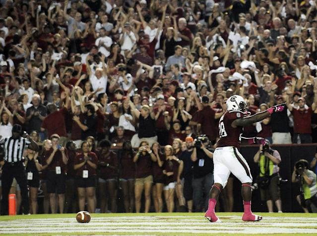 South Carolina running back Mike Davis (28) celebrates after scoring a touchdown against Kentucky during the first half of an NCAA college football game, Saturday, Oct. 5, 2013, in Columbia, S.C. (AP Photo/Rainier Ehrhardt)