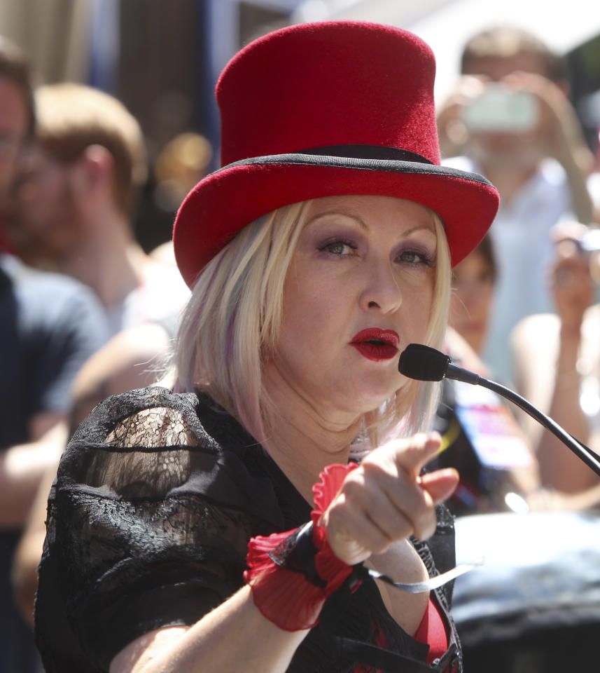 Grand Marshall Cyndi Lauper speaks to the media before the start of the Gay Pride Parade in New York, Sunday, June 24, 2012. The parade was held one year to the day of same-sex marriage being legalized in New York state. (AP Photo/Seth Wenig)