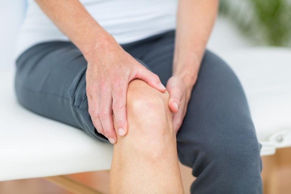 man with knee pain, health questions over 40