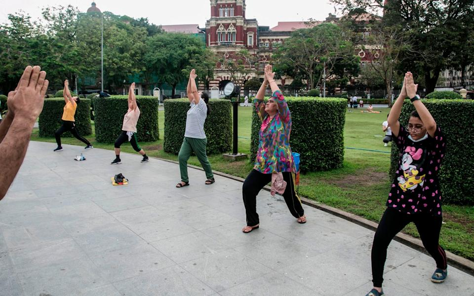 People exercise in a park in Yangon - SAI AUNG MAIN / AFP