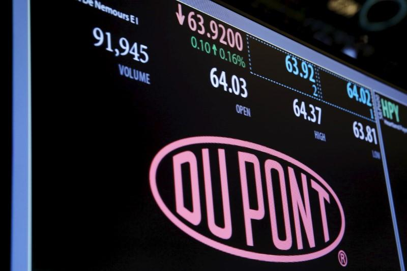 The Dupont logo is displayed on a board above the floor of the New York Stock Exchange shortly after the opening bell in New York