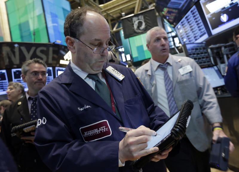 In this  April 24, 2013, photo, Trader Gordon Charlop, center, works on the floor of the New York Stock Exchange. World stock markets mostly rose Monday April 29, 2013 as weaker-than-expected U.S. growth added to expectations that central banks will continue easy monetary policies to support economic recovery. (AP Photo/Richard Drew)