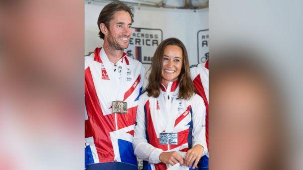 PHOTO: Pippa Middleton and James Matthews pose for photos after finishing their Race Across America bike race in Annapolis, Maryland, June, 21, 2014. (Drew Angerer/EPA)