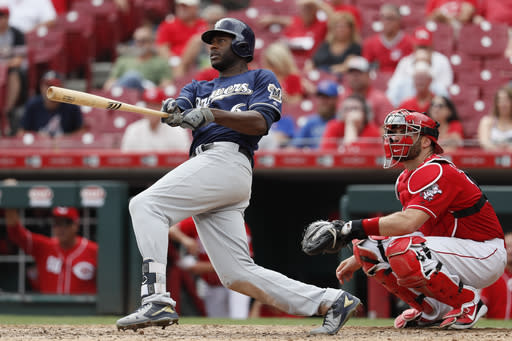 Milwaukee Brewers' Lorenzo Cain hits a solo home run off Cincinnati Reds relief pitcher Austin Brice in the eleventh inning of a baseball game, Thursday, Aug. 30, 2018, in Cincinnati. (AP Photo/John Minchillo)