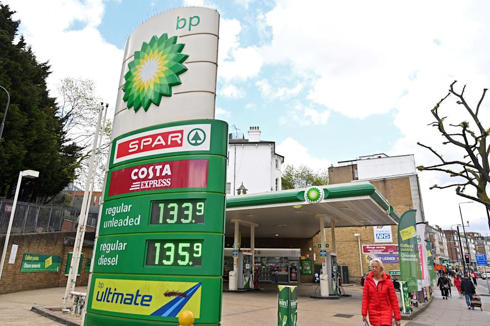 A pedestrian walks past a Costa Express and Spar Logo outside a BP petrol and diesel filling station in north London on May 12, 2021. - London-listed BP had suffered a vast $20.3-billion net loss last year, when the pandemic shuttered swathes of the global economy and slammed energy demand. BP returned to profit in the fourth quarter of 2020, aided by the gradual reopening of economies. (Photo by Glyn KIRK / AFP) (Photo by GLYN KIRK/AFP via Getty Images)