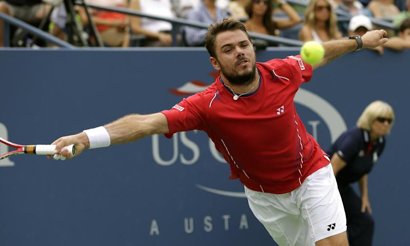 Stanislas Wawrinka, of Switzerland, lunges for a shot from Marcos Baghdatis, of Cyprus, during the third round of the 2013 U.S. Open tennis tournament, Sunday, Sept. 1, 2013, in New York. (AP Photo/Mike Groll)