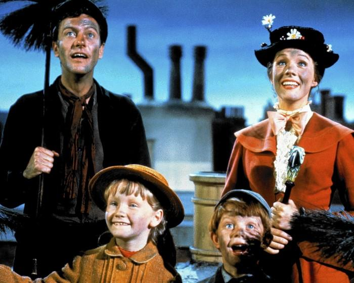 """Dick Van Dyke as Bert, Julie Andrews as Mary Poppins, Karen Dotrice as Jane Banks and Matthew Garber as Michael Banks in """"Mary Poppins"""" from 1964."""