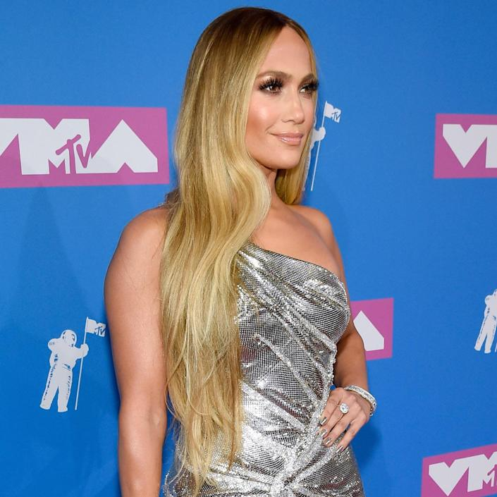 """For Jennifer Lopez — whose hair has been quite literally every shade of the blonde, bronde, and brunette rainbow — this might be one of her more successful permutations to date. """"J.Lo does what we refer to as a 'double process,' meaning she gets her gray roots covered and then gets highlights afterward,"""" explains Bradford. """"In contrast, if you have a dark base with little to no gray, you would want to ask for balayage and a gloss afterward to soften or """"bump"""" your dark base to a lighter chocolate tone."""" Bradford notes that it may take a few highlight sessions to get your color that blonde while keeping the hair's integrity."""