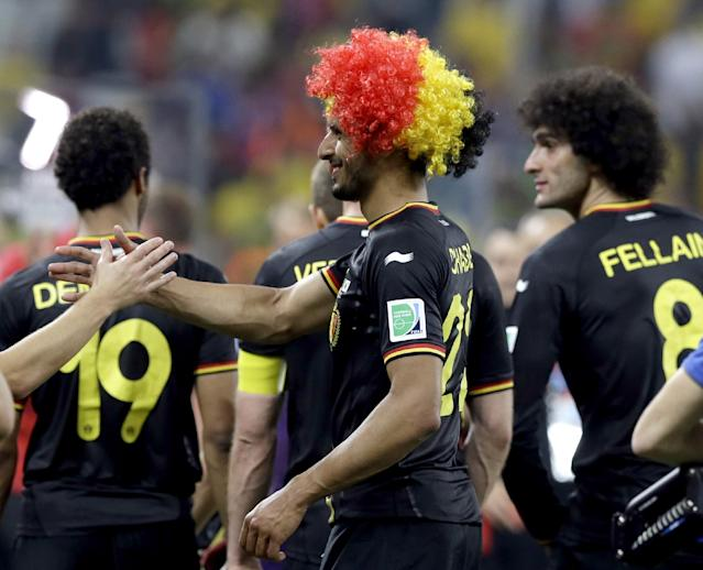 Belgium's Nacer Chadli, left, is congratulated by a teammate following Belgium's 1-0 victory over South Korea to Belgium during the group H World Cup soccer match between South Korea and Belgium at the Itaquerao Stadium in Sao Paulo, Brazil, Thursday, June 26, 2014. (AP Photo/Thanassis Stavrakis)