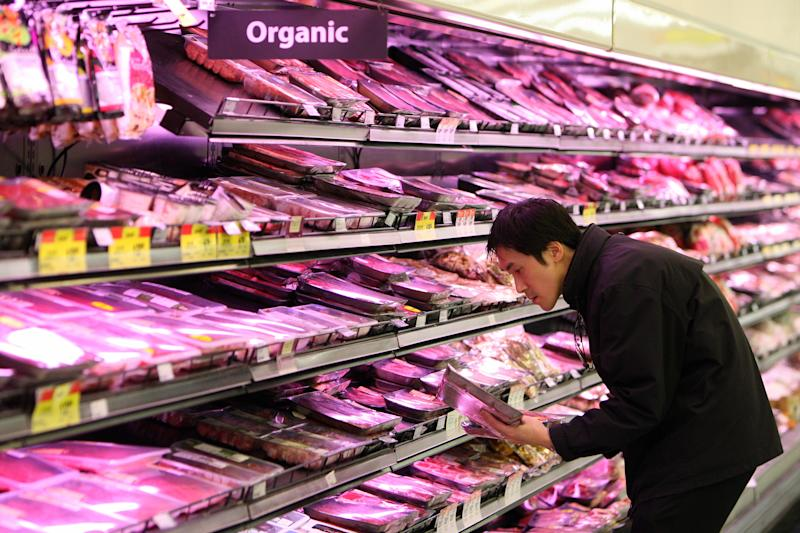 A customer selects meat products at a Woolworths Ltd. supermarket in Perth, Australia.
